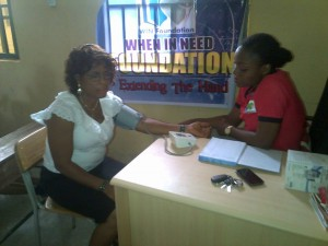 Win Foundation staff member conducting a blood pressure check