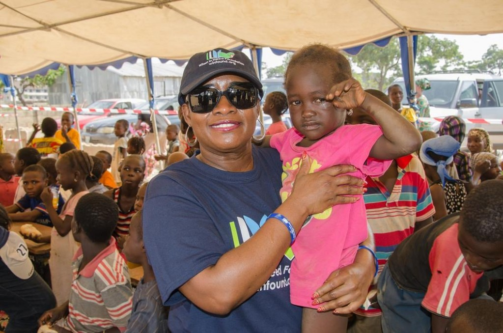 2. When In Need President, Ms Chetachi Ecton holding a child at the DP (Internally Displaced Persons) Camp in Kuchingoro, FCT Abuja Nigeria
